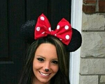 Minnie Mouse ears with a red or pink polka dot bow. One size fits most 4yrs to adult.
