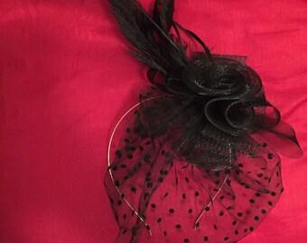 Black fascinator on metallic silver headband