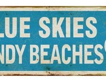 Metal sign Blue Skies & Sandy Beaches
