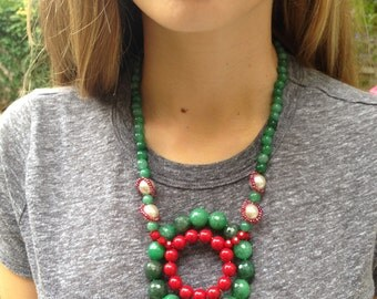 A green, red and white necklace