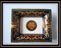 Darkblue porcelain ashtray with lion.