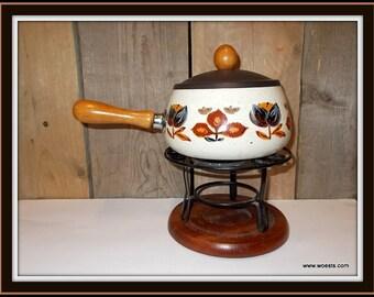 Vintage enamel fondue set complete with base and lid.