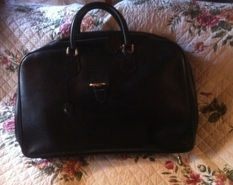Suitcase in pure black leather vintage