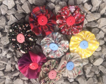 Yoyo flower hair clip with button detail