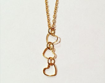 Cascading tiny heart necklace in gold