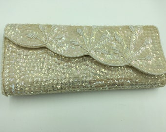 La Regale beaded and sequence evening clutch in its original box, Ivory color with a  pink hue to the beads.