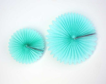 Aqua blue tissue paper pinwheel.  8 inch or 12 inch.  Light blue rosette.  Sky blue pinwheel fan.  Aqua blue pinwheel party decorations.
