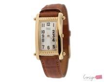 Vintage Caravelle by Bulova Gold Tone Rectangular Wrist Watch