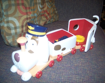 Dog train conductor toy