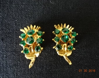 Clip on emerald green rhinestone and gold toned earrings