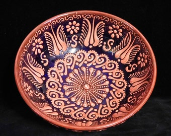 Intricate slip decorated earthenware bowl