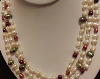 Pearl continuous strand.  Hand knotted fresh water pearls.