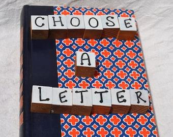 Readers Digest Book Letter-Orange/Blue Pattern