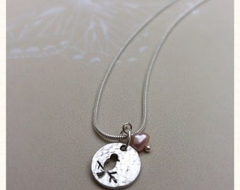 Silver Coin bird charm necklace with freshwater pearl
