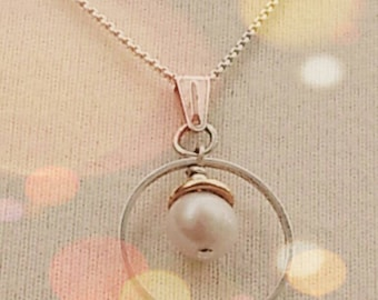Freshwater Pearl in gold and silver pendant on silver chain