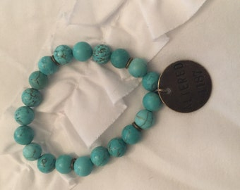 Turquoise bead bracelet with altered charm