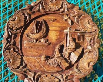 Wood intricately carved nautical/seaside scene