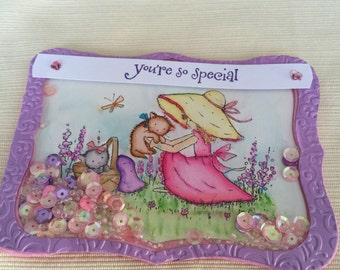 3D shaker card with watercolored oudoor scene which includes girl playing with cute kitties and a kitten basket