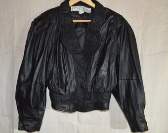 80's Black Leather Jacket, 3/4 Sleeve, Huge Shoulder Pads and Tight Fitting Waist! Medium Size.