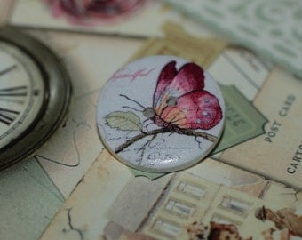 set of four woody buttons with butterfly
