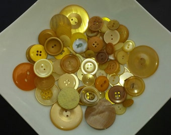 Lot of different colours yellow vintage buttons