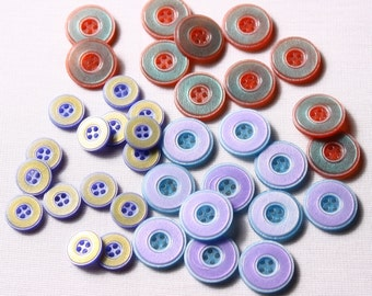 12 13mm and 18mm, 2-tone round, 4-hole buttons (7083)