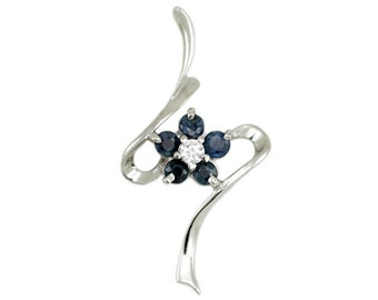 Superb pendant in 825 sterling silver rhodium set with natural blue sapphires, flower shaped