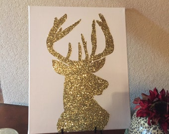 Gold deer on white canvas