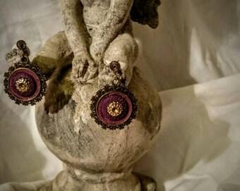 Boucles d'oreilles percées violettes