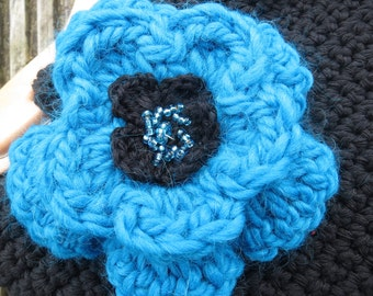 Hand crocheted layered flower brooch in teal and black