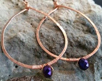 Artisan made hand hammered copper and  purple multi facet glass beads ladies hoop earrings.