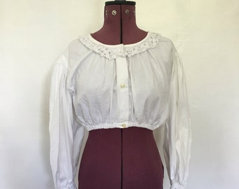 White Linen top with crochet detail.