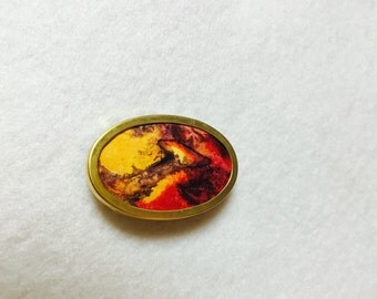 Hand painted 100% pure silk brooch mounted on a gold plated setting