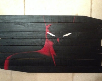 Paint batman on recycled pallet wood