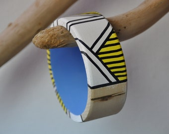 Beauty on the arm of the beholder. One off hand painted wooden bracelets.