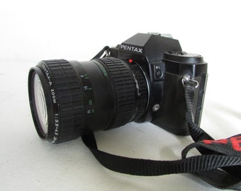 A good Pentax P30 35mm camera with 28-80mm lens