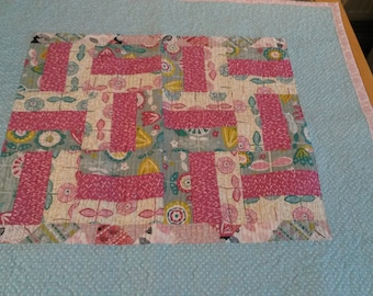 Patchwork baby quilt.