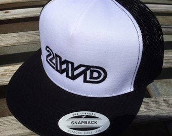 Volkswagen Vanagon 2WD Trucker Hat.  Structured front with embroidered 2WD design.  Mesh back with classic snap clasp.