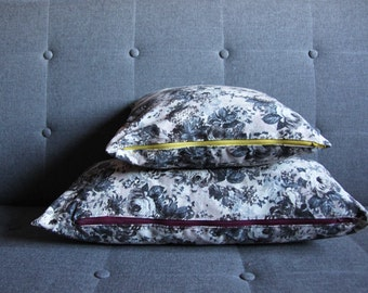 Cushions decorated with flowers with contrasting zip vintage