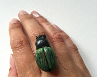 Green beetle ring.