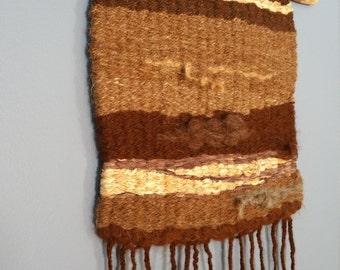 Earth tone peg-weaving tapestry