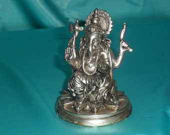 Nice brass Ganesh statue in silver plated. The thin layer of pure silver makes the statue very shining.