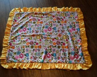Riley Blake Sunny Happy Skies Pink Minky with Brown Dot Minky and a yellow satin ruffle blanket
