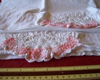 2 handmade pillow cases with salmon/coral and white crocheted trim