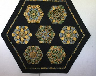 Wall hanging or table topper.  Made from 100% cotton,machine pieced and quilted.  Measures 37 inches by 32 inches.