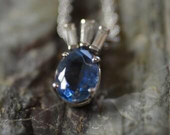 14karat white gold Blue Topaz and Diamond Pendant on chain