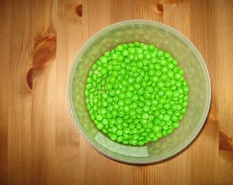 Half pound of green lime Skittles