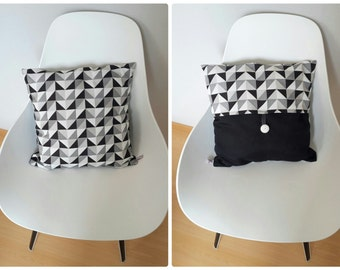Cushion cover geometric patterns in shades of grey, black and white