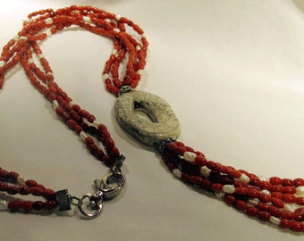 Long necklace of freshwater pearls and coral paste Raku pendant