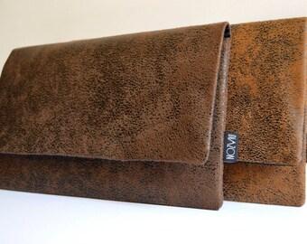 The JACKAROO faux leather hand bag purse